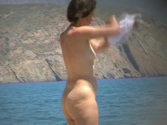 Nude mature takes a nice swim