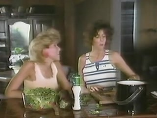 Two horny lesbian sluts in a retro porn video