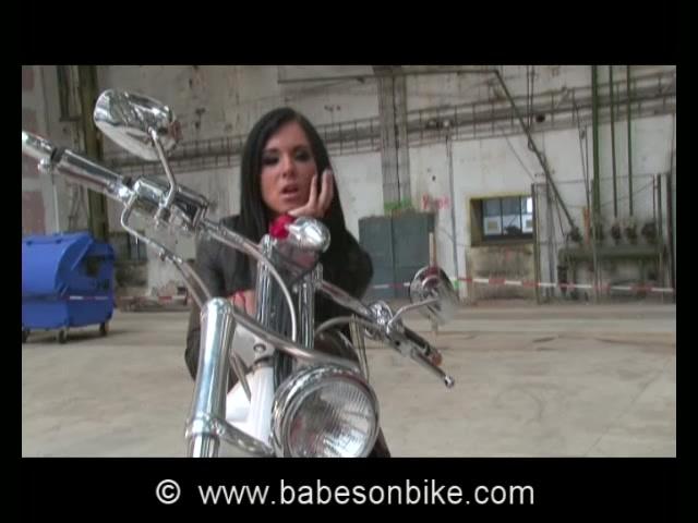 Naked dame is nasty on bike