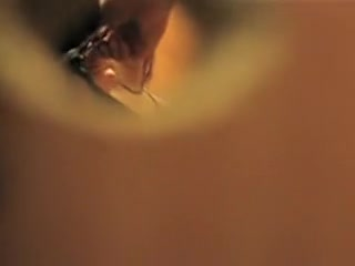 Girl spied through key hole baring tits off the bra