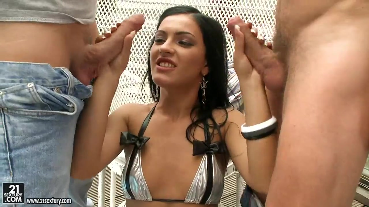 honey demon kneels and sucks two big cocks