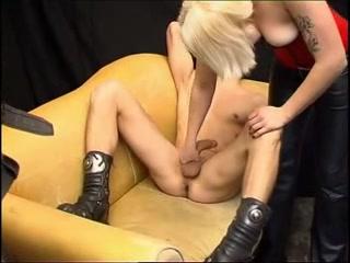 Blonde teen dominates a bald man in BDSM dungeon